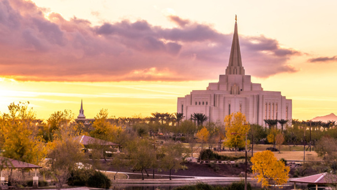 A view of the Gilbert temple and its surroundings at sunset.