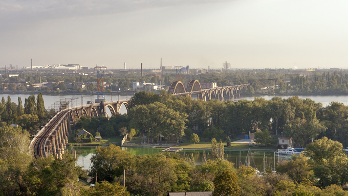 Merefa-Kherson railroad bridge with arches over Dnieper river in Dnepropetrovsk, Ukraine. Built in 1914-1932.