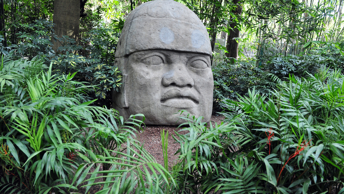 Olmec colossal head from the pre-Columbian heritage of Mexico in Mexican National Museum of Anthropolog the Mexico City, Mexico.