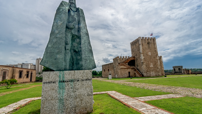Statue of Gonzalo Fernandez de Oviedo in front of fortress in old part of Santo Domingo.