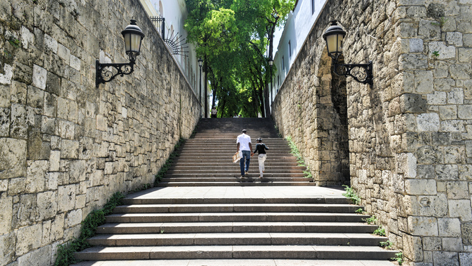Father and daughter walking the steps of El Conde Street in Santo Domingo.