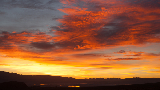 An orange sunrise over Owens Lake.