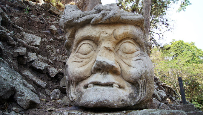 Stone head of old man on the ruins of Copan, Honduras