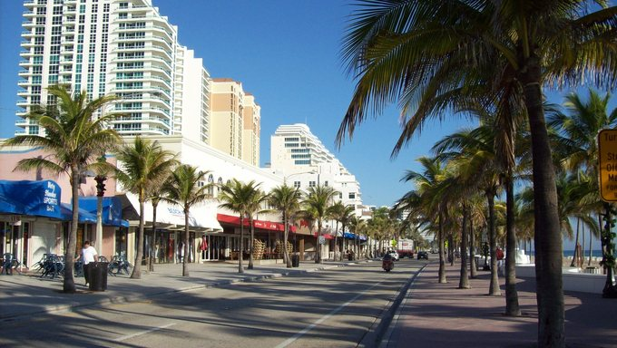 Palm-tree lined street in Ft. Lauderdale along the ocean.