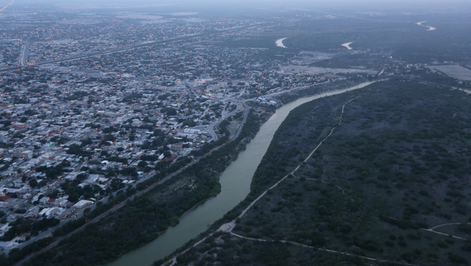 An aerial shot of the Rio Grande River, the border between Mexico and the United States. Reynosa, Mexico is on the left with McAllen on the right.
