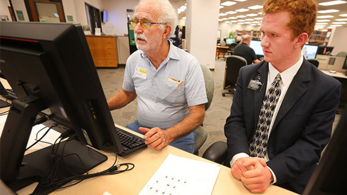 David Sherman of Winter Haven Florida, receives some help from Elder Taylor Fairbanks of Maryland as members of the Family and Church History Headquarters Mission work Friday, Sept. 4, 2015, at Temple Square in Salt Lake City.