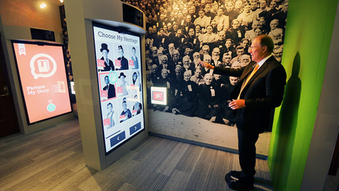 President Warren Tate demonstrates some of the tools in the new Family Discovery Center. Family and Church History Headquarters Mission Friday, Sept. 4, 2015, at Temple Square in Salt Lake City.