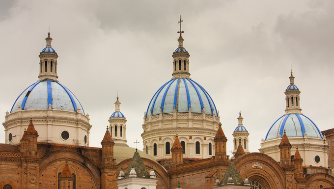 The blue tiled domes of Cathedral of the Immaculate Conception in Cuenca Ecuador which is also known as the New Cathdral.