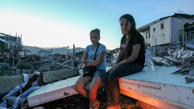 Survivors of Typhoon Haiyan light candles to their departed loved ones when Typhoon Haiyan (local name Yolanda) struck central Philippines last November 8, 2013 killing more than 6,000 people.