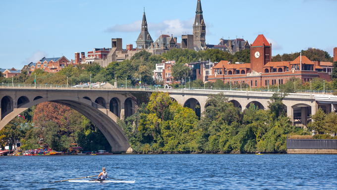 Rowing Potomac River Key Bridge Georgetown University Washington DC from Roosevelt Island.  Completed in 1923 this is the oldest bridge in Washington DC.