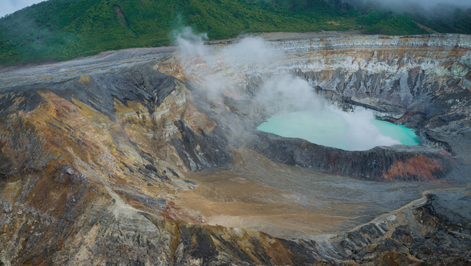 Fumes coming out of the hot Poas volcano lagoon, Costa Rica, Central America