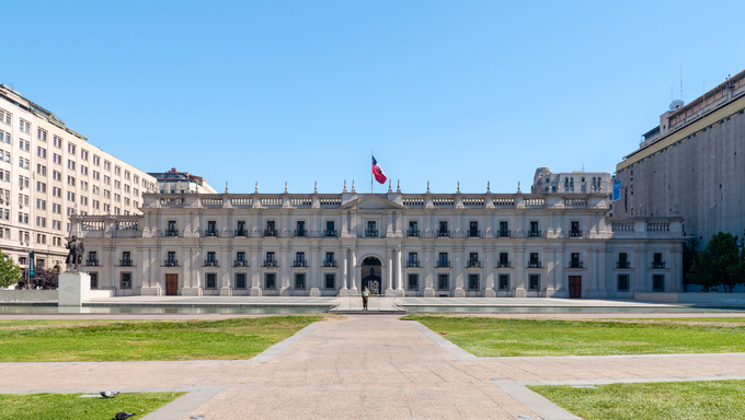 Santiago, Chile - December 2, 2012: The Presidential Palace in Santiago Chile. Also called La Moneda. This is the palace for the President of the Republic of Chile, but also contains the seats and offices for the Minister of the Interior, General Secretariat of the Presidency and General Secretariat of the Government.