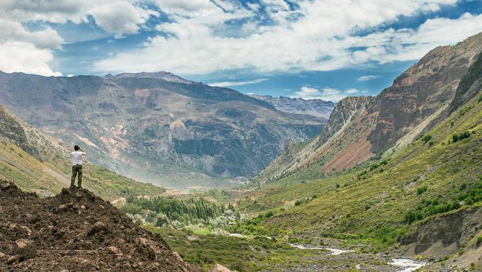 Man explores the horizon in the mountains