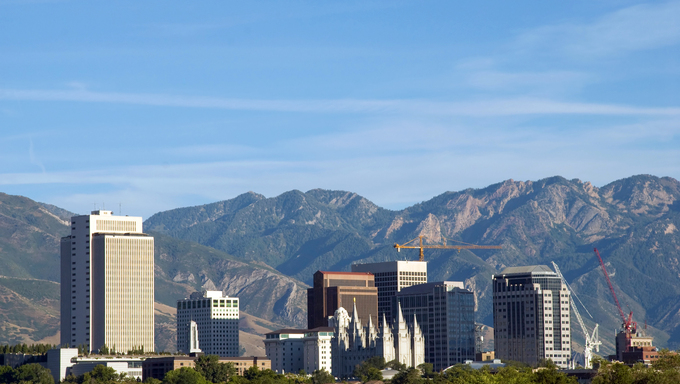Skyline of Salt Lake City, Utah.  The image shows the downtown buildings and skyline, the historic Mormon temple, and the Wasatch mountains in the background.