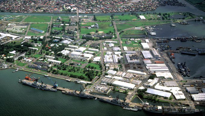A view of the Naval Base, Subic Bay, with the city of Olongapo in the background.  The ships docked at the pier in the foreground are, from right: the oiler USNS HASSAYAMPA (T-AO-145), the guided missile cruiser USS STERETT (CG-31), the guided missile destroyer USS HENRY B. WILSON (DDG-7) and the guided missile cruiser WILLIAM H. STANDLEY (CG-32).
