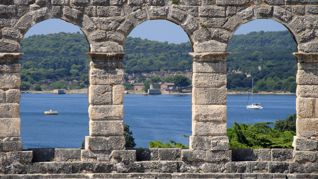 View of the Adriatic sea through the windows of the amphitheater of Pula, Croatia.