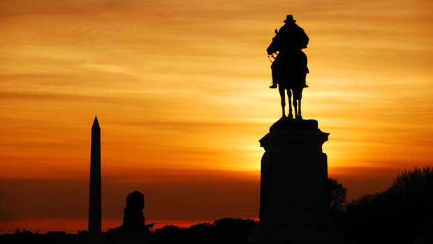 Statue of General Grant silhouette of US grant memorial and Washington Monument at sunset, Washington DC.