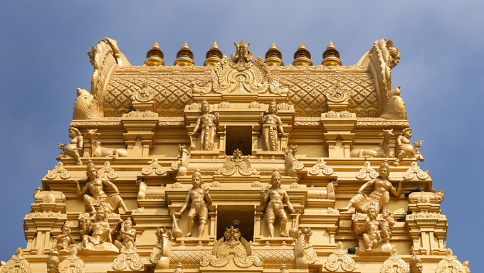 Plenty of golden statues on the top of the entrance tower at Sri Naheshwara in Bengaluru.