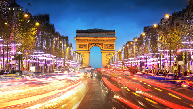 Arc de triomphe Paris city at sunset. The Arch de Triomphe and Champs Elysees.