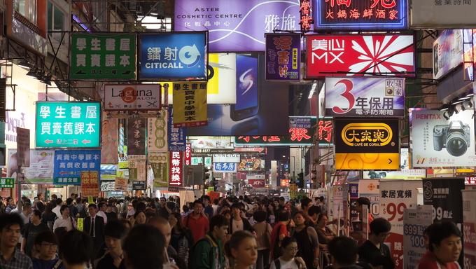 Busy street market at Night. Hong Kong.