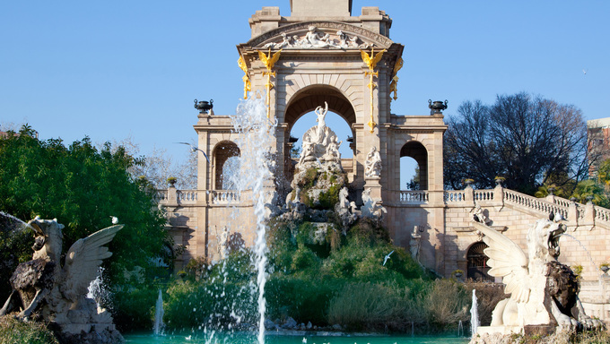 Barcelona Ciudadela park lake fountain with golden Quadriga of Aurora.