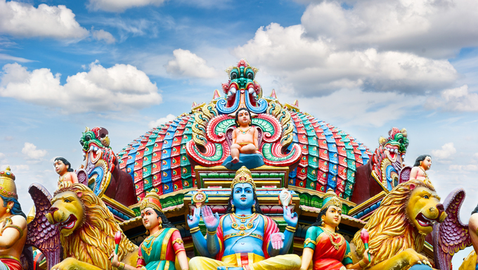 Detail of Sri Mariamman temple in Singapore over beautiful blue sky