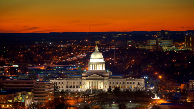 Little Rock Capitol and city lights after sunset.