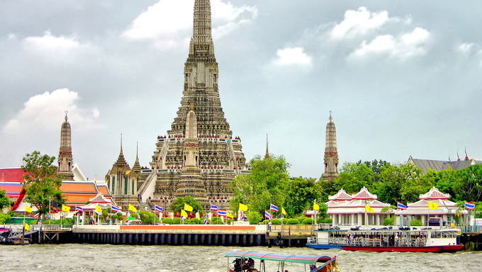 Buddhist temple Wat Arun along the Chao Phraya River in Bangkok, Thailand