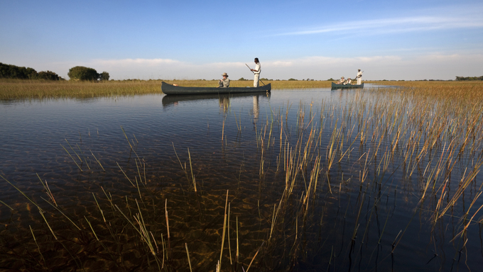 Tourists on the Okavango Delta in Botswana.