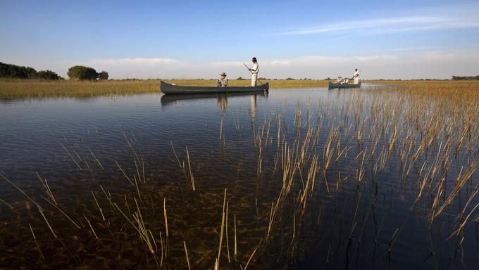 Tourists on the Okavango Delta in Botswana.