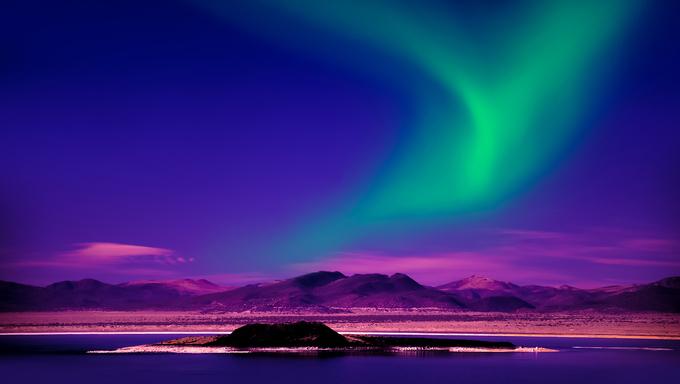 A display of the Northern lights over an Alaskan lake.