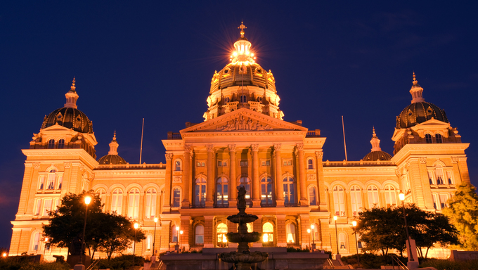 The Iowa state capitol building at night.