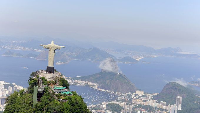 Christ Redeemer Statue and Sugarloaf Mountain in Rio de Janeiro, Brazil.