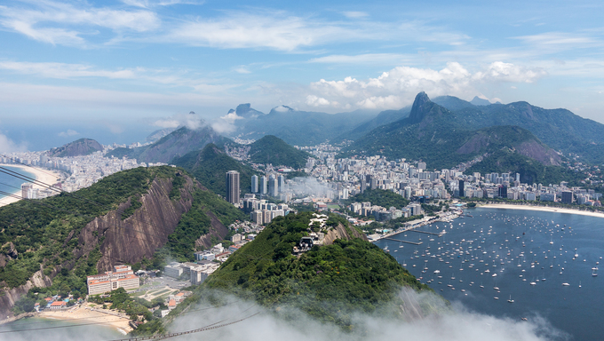 Aerial view of city and harbor of Rio de Janeiro in Brazil from cable car on Sugarloaf Mountain.