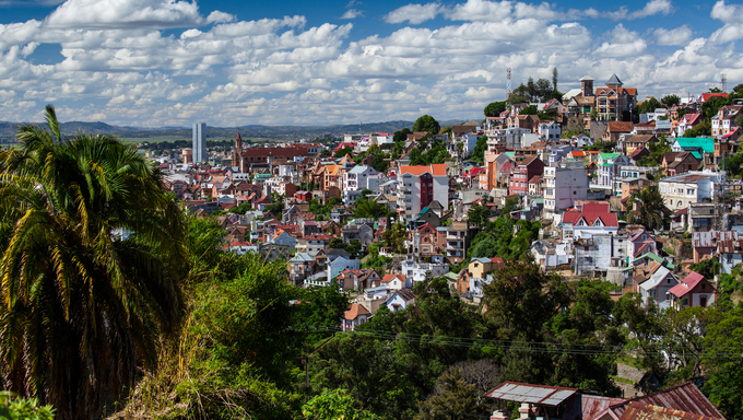 The city of Antananarivo on sunny day with fluffy clouds in the sky.