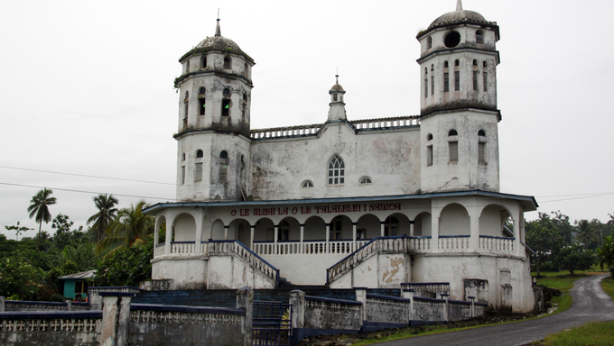 Gray church near the road in Savaii island, Samoa