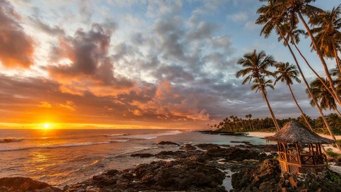 Return to Paradise with amazing seascape at sunset in Lefaga Beach, Samoa.