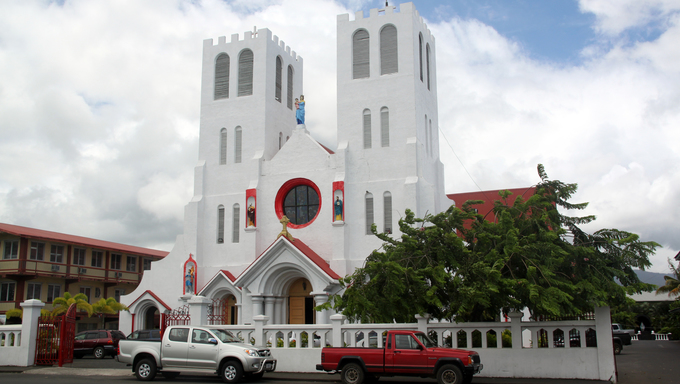 White catholic church on the street in Apia, Samoa