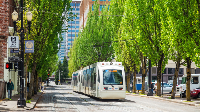 Light train of the Portland Streetcar system in Portland, Oregon. The Portland Streetcar system opened in 2001 and serves areas surrounding downtown Portland.