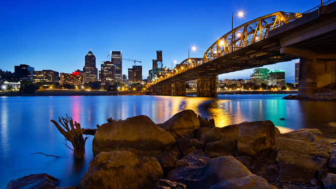 Portland Oregon City Skyline along Willamette River at Blue Hour.