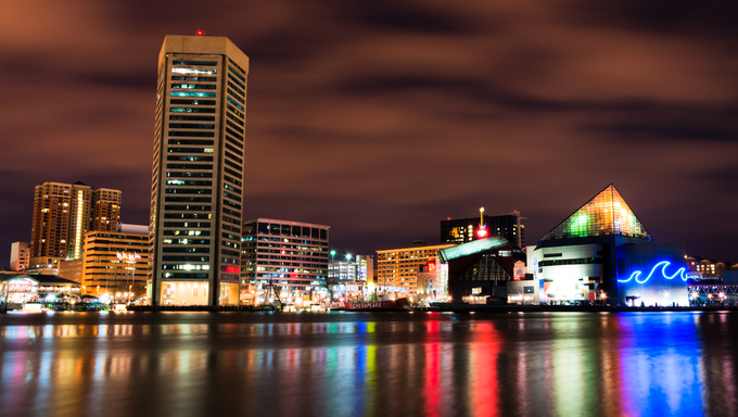 Long exposure of the colorful Baltimore skyline at night, Maryland.