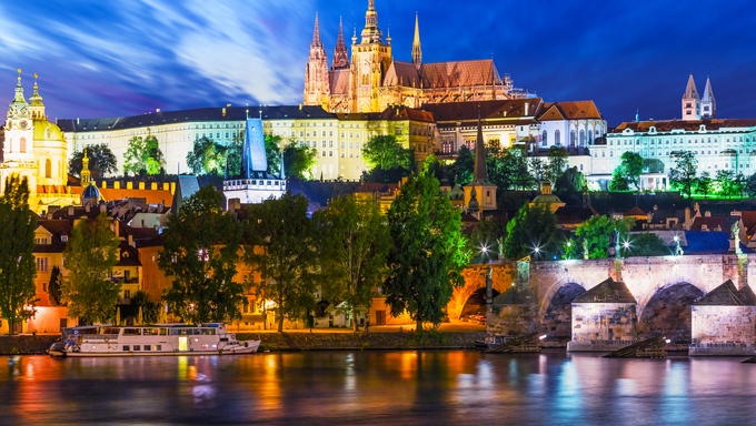 Scenic summer night panorama of the Old Town architecture with Vltava river and St.Vitus Cathedral in Prague, Czech Republic