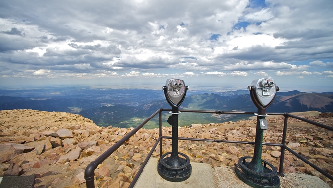 Pikes Peak Binoculars and Colorado Springs Under Cloudy Sky. Colorado USA. Pikes Peak East View.