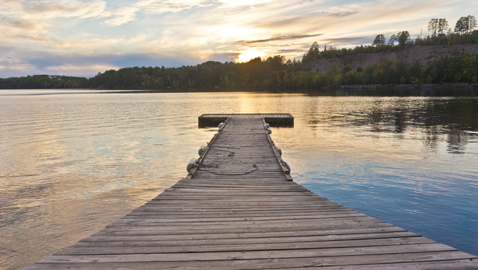 Boat dock on White Iron Lake at Sunset.