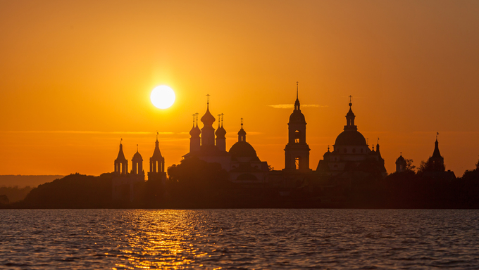 Monastery silhouette against the setting sun at the Lake Nero, Rostov, Russia