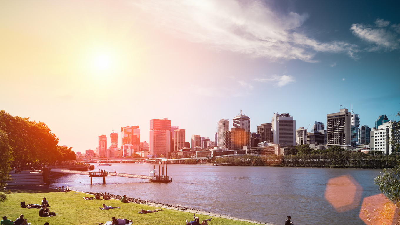 brisbane skyline and people in lawn against a blue sky,queensland, Australia