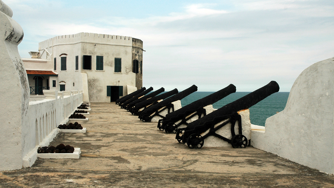 Cannons and balls along ocean wall at Cape Coast castle in Ghana
