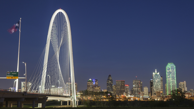 The Margaret Hunt Hill Bridge and Downtown Dallas at night in Texas.
