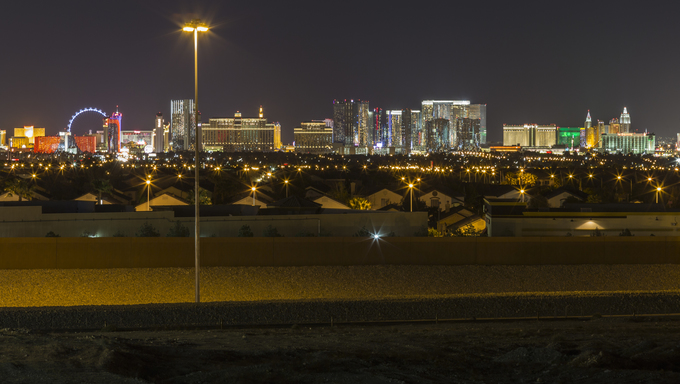 Las Vegas, Nevada, USA - March 27, 2014:  Sleepy bedroom community homes under the glow of Las Vegas strip casino resorts.