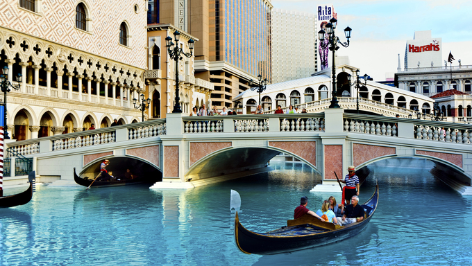 LAS VEGAS, NEVADA - JULY 17: Venice Theme Venetian with Gondola on water and Caesars Casino Hotel, July 17, 2008 in Las Vegas, Nevada.